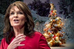 Sarah Palin stands before an erect Christmas tree.
