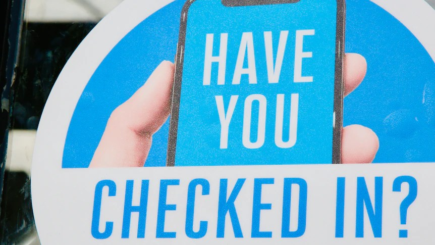 A blue sign shows a hand with a phone and the words 'HAVE YOU CHECKED IN?'.