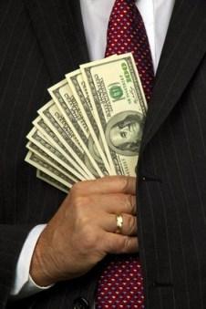Money-Stuffed-Into-Pocket
