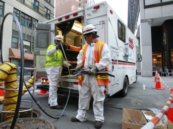 Verizon workers install fiber optic cables in New York City.