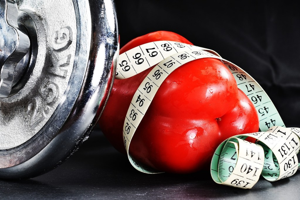 Weight with a red pepper and measuring tape wrapped around it. Busting Bariatric Myths