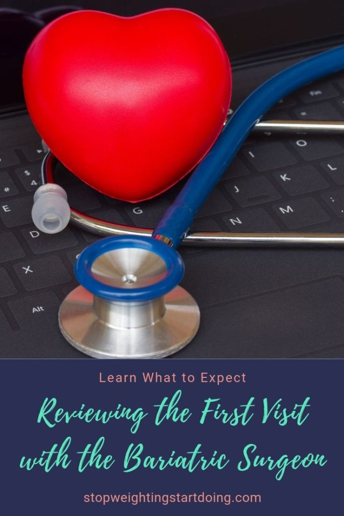 A red heart-shaped stress ball on a black laptop with a blue stethoscope around it. Reviewing the first visit with the bariatric surgeon.