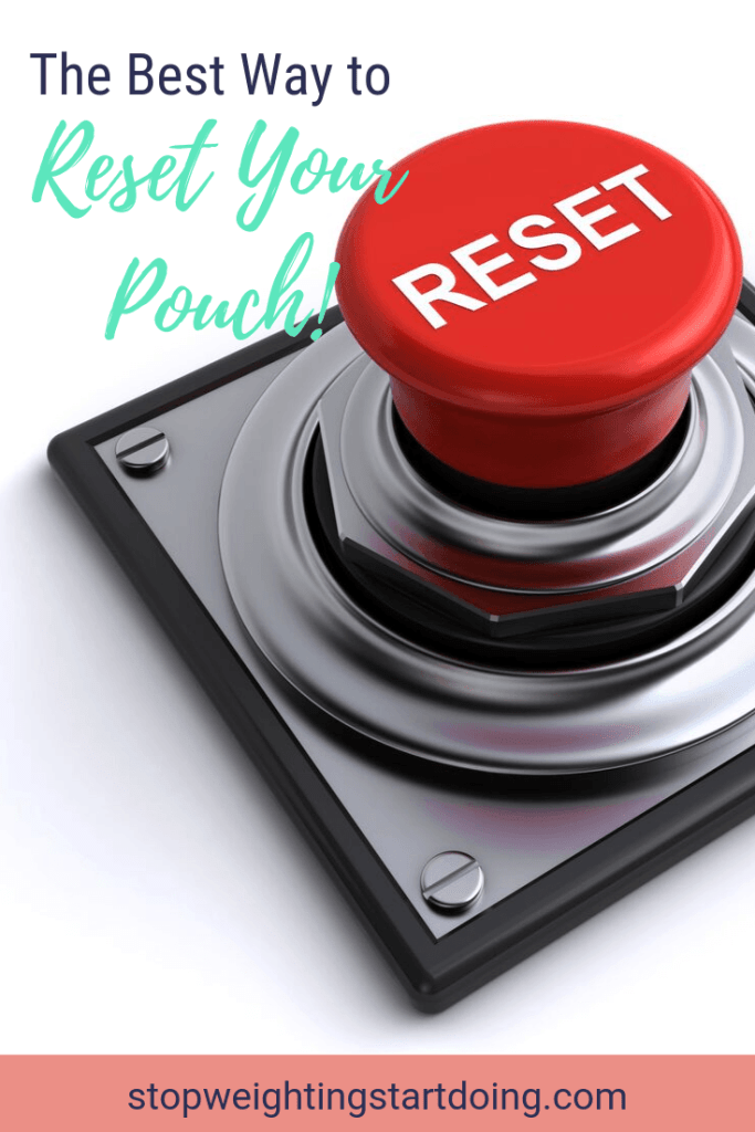 A red reset button on a silver knob. | The Best Way to Reset Your Pouch | 5-Day Pouch Reset Vs. Intermittent Fasting | Pinterest Image
