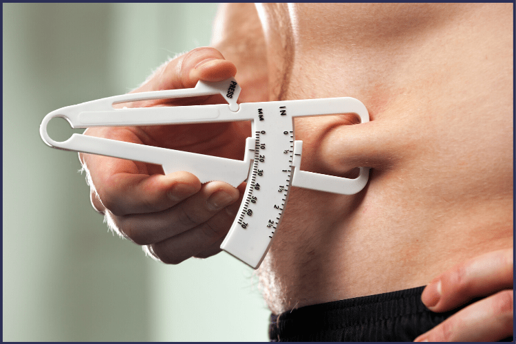 A man measuring his body fat with a tool. | Why the BMI for Bariatric Surgery Needs to be Lowered | Include Obesity Class I | Graphic | BMI for weight loss surgery, BMI Calculator