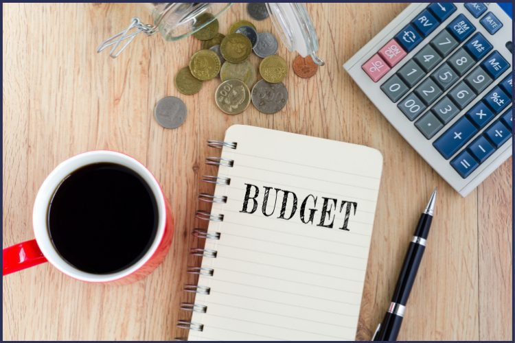 A budget notebook with coins, a calculator, and a red cup of coffee. | This is How to Use Medical Flex Spending for Bariatric Surgery | Graphic | FSA, Bariatric Vitamins, FSA Eligible