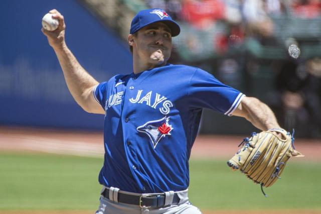 Toronto Blue Jays starting pitcher Ross Stripling delivers against the Cleveland Indians during the first inning of the first baseball game of a doubleheader in Cleveland, Sunday, May 30, 2021. (AP Photo/Phil Long)