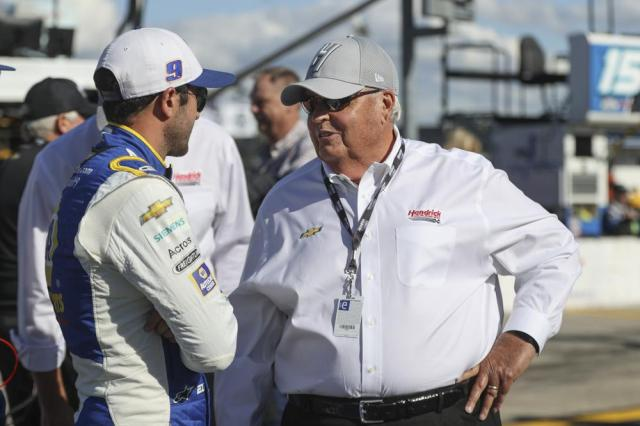 Driver Chase Elliott, left, talks to car owner Rick Hendrick before a NASCAR Cup Series auto race at Charlotte Motor Speedway in Concord, N.C., Sunday, May 30, 2021. (AP Photo/Nell Redmond)