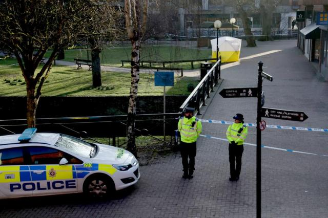FILE - In this Wednesday, March 7, 2018 file photo, police officers guard a cordon around a police tent covering the the spot where former Russian double agent Sergei Skripal and his daughter were found critically ill. British police said Tuesday, Sept. 21, 2021 they are charging a third Russian suspect in the 2018 nerve agent attack on a former Russian agent in England. Scotland Yard said prosecutors believe there is sufficient evidence to charge a man known as Sergey Fedotov with conspiracy to murder, attempted murder, possessing and using a chemical weapon, and causing grievous bodily harm.  Former Russian spy Sergei Skripal and his daughter, Yulia, were targeted in a nerve agent attack in 2018 in Salisbury, England. (AP Photo/Matt Dunham, File)