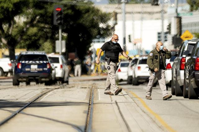 Law enforcement officers respond to the scene of a shooting at a Santa Clara Valley Transportation Authority (VTA) facility on Wednesday, May 26, 2021, in San Jose, Calif. Santa Clara County sheriff's spokesman said the railyard shooting left multiple people, including the shooter, dead. (AP Photo/Noah Berger)