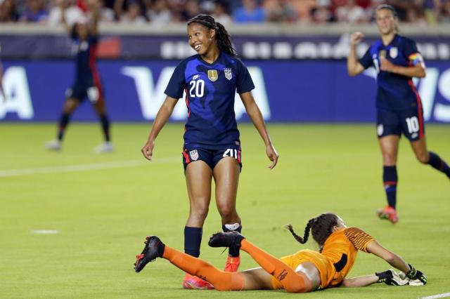 U.S. midfielder Margaret Purce (20) reacts to her goal over Jamaica goalkeeper Chinyelu Asher (7) during the first half of their 2021 WNT Summer Series soccer match, Sunday, June 13, 2021, in Houston. (AP Photo/Michael Wyke)