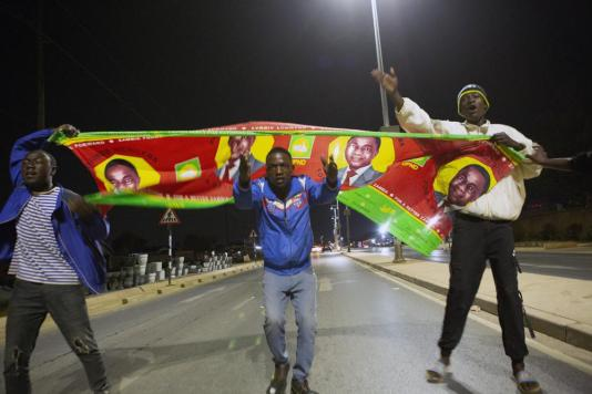 Supporters of main opposition leader Hakainde Hichilema celebrate on the streets of Lusaka, Zambia, Sunday, Aug. 15, 2021. Hichilema is inching towards clinching the country's presidency, with the latest results showing him with a commanding lead. (AP Photo/Tsvangirayi Mukwazhi)