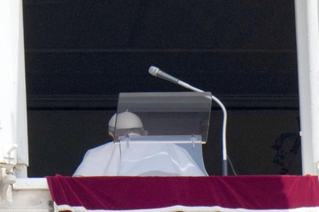 Pope Francis leaves after reciting the Angelus noon prayer from the window of his studio overlooking St.Peter's Square, at the Vatican. In a brief announcement Sunday afternoon the Vatican said Pope Francis has gone to a Rome hospital for scheduled surgery for a stenosis, or restriction, of the large intestine. (AP Photo/Alessandra Tarantino)