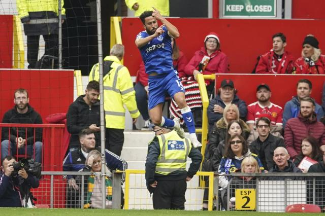 Everton's Andros Townsend celebrates after scoring his side's opening goal during the English Premier League soccer match between Manchester United and Everton, at Old Trafford, Manchester, England, Saturday, Oct. 2, 2021. (AP Photo/Dave Thompson)