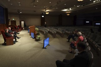 The Church of Jesus Christ of Latter-day Saints sat 6 feet apart inside an empty room as they  carried out its signature conference adhering to social distancing guidelines