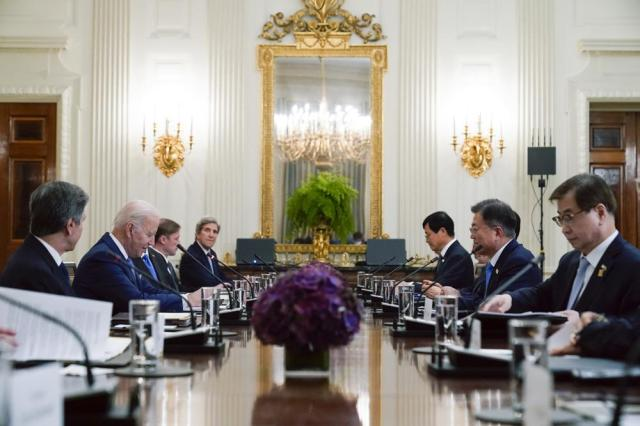 President Joe Biden speaks during a meeting with South Korean President Moon Jae-in, second from right, in the State Dinning Room of the White House, Friday, May 21, 2021, in Washington. (AP Photo/Alex Brandon)
