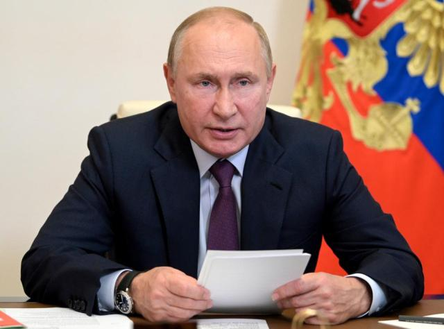 Russian President Vladimir Putin chairs a Security Council meeting via video conference at the Novo-Ogaryovo residence outside Moscow, Russia, Monday, Sept. 27, 2021. (Alexei Druzhinin, Sputnik, Kremlin Pool Photo via AP)
