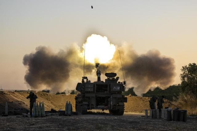 An Israeli artillery unit fires shells towards targets in Gaza Strip, at the Israeli Gaza border, Wednesday, May 19, 2021. (AP Photo/Tsafrir Abayov)