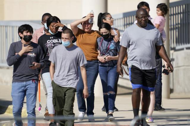 Families depart the Mansfield ISD Center For The Performing Arts Center where families were reunited with Timberview High School Students, Wednesday, Oct. 6, 2021 in Mansfield, Texas. Police in Texas have arrested a student suspected of opening fire during a fight at his Dallas-area high school, leaving four people injured. (AP Photo/Tony Gutierrez)