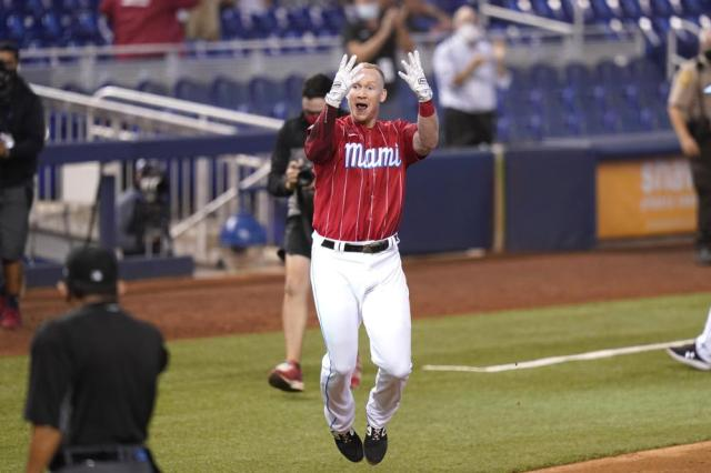 Miami Marlins' Garrett Cooper celebrates after hitting a walk-off two-run home run in the ninth inning of a baseball game against the New York Mets, Saturday, May 22, 2021, in Miami. The Marlins won 3-1. (AP Photo/Lynne Sladky)