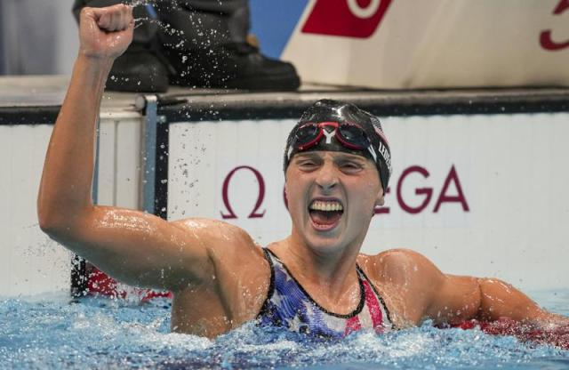 FILE - Katie Ledecky reacts after winning the women's 1500-meters freestyle final at the 2020 Summer Olympics in Tokyo, in this Wednesday, July 28, 2021, file photo. Ledecky announced Wednesday, Sept. 22, 2021, that she is moving to the University of Florida to be closer to home and train under Anthony Nesty, a rising star coach who will oversee her preparations for the 2024 Paris Olympics. Ledecky, a seven-time Olympic gold medalist, spent the last five years at Stanford University, where she worked with U.S. national team coach Greg Meehan while earning a psychology degree. (AP Photo/Matthias Schrader, File)