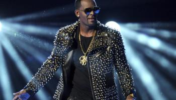FILE - R. Kelly performs at the BET Awards on June 30, 2013, in Los Angeles. R. Kelly's new lawyers are asking a judge to postpone his Aug. 9, 2021, sex trafficking trial in New York City, arguing they haven't had enough time to prepare because he's under a mandatory jail quarantine. (Photo by Frank Micelotta/Invision/AP, File)