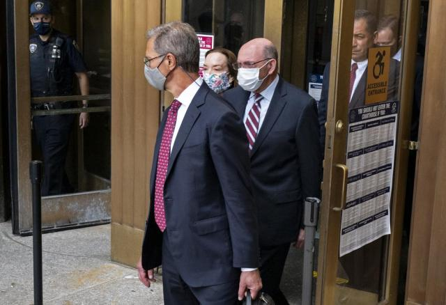 """The Trump Organization's Chief Financial Officer Allen Weisselberg, center, leaves after a courtroom appearance in New York, Monday, Sept. 20, 2021. Donald Trump's company and its longtime finance chief were charged Thursday in what a prosecutor called a """"sweeping and audacious"""" tax fraud scheme that saw the Trump executive allegedly receive more than $1.7 million in off-the-books compensation, including apartment rent, car payments and school tuition. (AP Photo/Craig Ruttle)"""