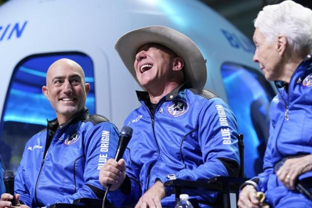 Mark Bezos, left, Jeff Bezos, center, founder of Amazon and space tourism company Blue Origin, and Wally Funk, right, make comments during a post launch news briefing from its spaceport near Van Horn, Texas, Tuesday, July 20, 2021. (AP Photo/Tony Gutierrez)