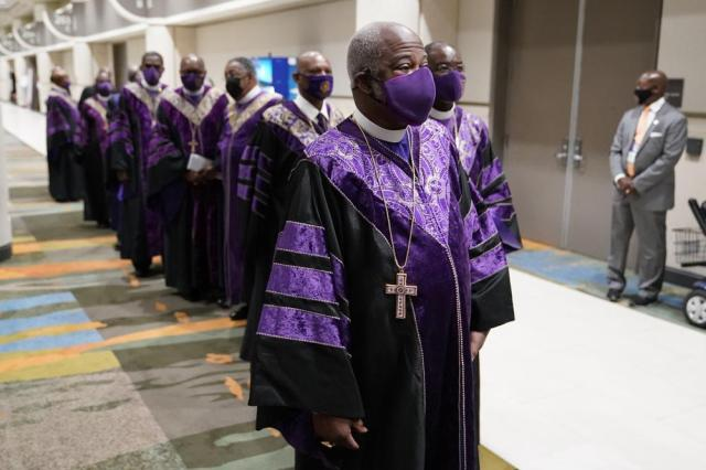 Bishop Michael Mitchell, front, lines up with other bishops for a processional prior to the opening worship service at the African Methodist Episcopal Church conference Tuesday, July 6, 2021, in Orlando, Fla. (AP Photo/John Raoux)