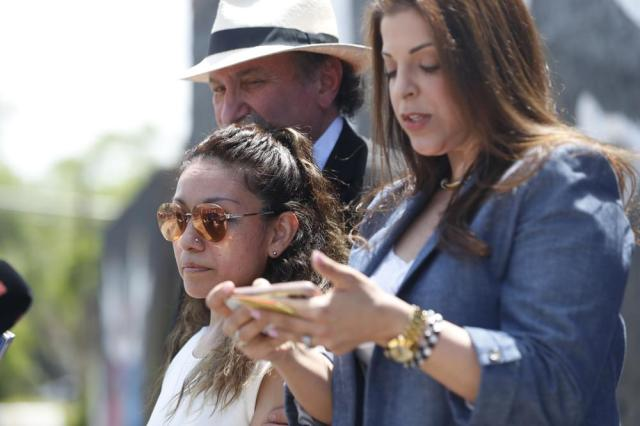 Toledo family attorney Adeena Weiss-Ortiz, right, speaks in behalf of Adam Toledo's mother Elizabeth Toledo, center, during a news conference announcing the opening of Adam's Place Inc., a not-for profit organization aiming to help at-risk youth from Chicago and other Midwestern cities to remain out of trouble, Wednesday, May 26, 2021 in Chicago's West Side. Adam Toledo, 13,  was shot and killed March 29 by a Chicago police officer. (AP Photo/Shafkat Anowar)