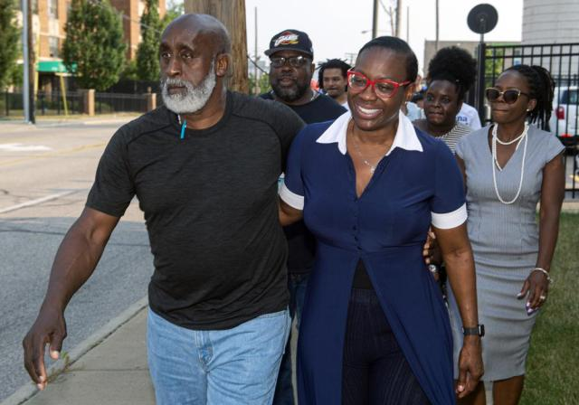 In this July 7, 2021, photo Nina Turner, right, a candidate running in a special Democratic primary election for Ohio's 11th Congressional District walks with her father, Tallib Ilaahee to the Cuyahoga County Board of Elections before casting their votes in Cleveland. (AP Photo/Phil Long)