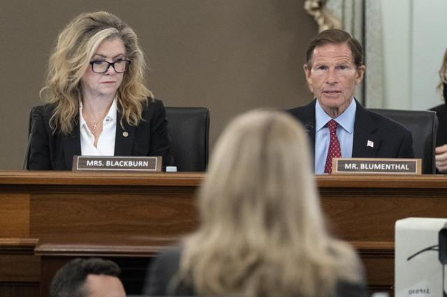 Sen. Marsha Blackburn, R-Tenn., left, and Sen. Richard Blumenthal, D-Conn., right speak to former Facebook data scientist Frances Haugen, center, during a hearing of the Senate Commerce, Science, and Transportation Subcommittee on Consumer Protection, Product Safety, and Data Security, on Capitol Hill, Tuesday, Oct. 5, 2021, in Washington. (AP Photo/Alex Brandon)