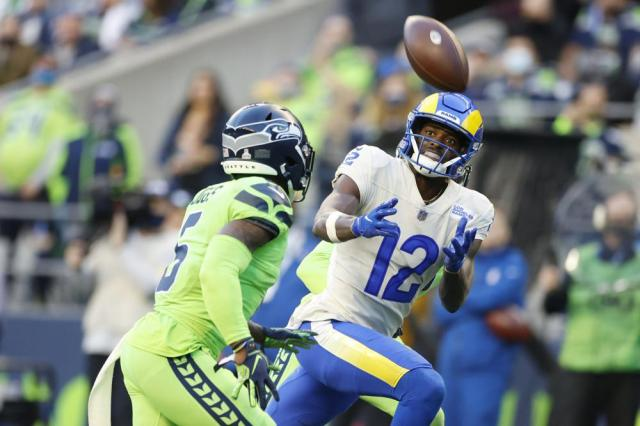 Los Angeles Rams wide receiver Van Jefferson (12) eyes an incomplete pass as Seattle Seahawks free safety Quandre Diggs (6) moves in during the first half of an NFL football game, Thursday, Oct. 7, 2021, in Seattle. (AP Photo/Craig Mitchelldyer)