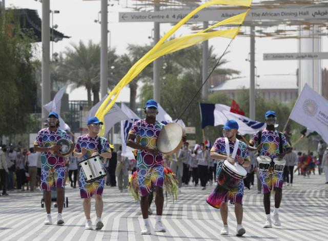 Marchers parade during the French ceremonial day at the Dubai Expo 2020 in Dubai, United Arab Emirates, Saturday, Oct, 2, 2021. (AP Photo/Kamran Jebreili)