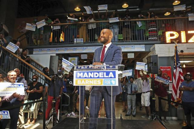 Wisconsin Lt. Governor, Mandela Barnes takes in the crowd before announcing that he will be running for U.S. Senate at the Sherman Phoenix on Tuesday, July 20, 2021, in Milwaukee. Barnes has joined the crowded Democratic field for the U.S. Senate seat currently held by Republican Sen. Ron Johnson. (Angela Peterson/Milwaukee Journal-Sentinel via AP)