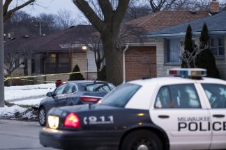 There's a devil loose: Police search a home on Milwaukee's north side as they look for more information regarding this tragic murder-suicide