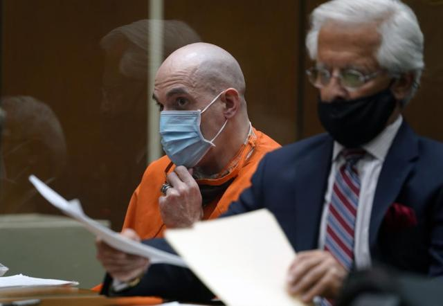 """Michael Thomas Gargiulo, left, listens to his defense attorney Daniel Nardoni, as he pleads for his client during a sentencing hearing at Los Angeles Superior Court, Friday, July 16, 2021.  A judge denied a new trial for Garigiulo, a man prosecutors called """"The Boy Next Door Killer,"""" who could be sentenced to death later Friday for the home-invasion murders of two women and the attempted murder of a third. (AP Photo/Damian Dovarganes)"""