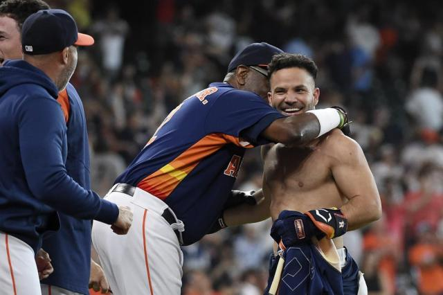 Houston Astros' Jose Altuve, right, celebrates his winning three-run home run with manager Dusty Baker Jr., left, during the ninth inning of a baseball game against the New York Yankees, Sunday, July 11, 2021, in Houston. (AP Photo/Eric Christian Smith)