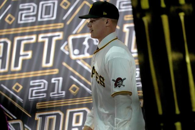 Louisville's Henry Davis walks across the stage after being selected by Pittsburgh Pirates as the number one overall pick in the first round of the 2021 MLB baseball draft, Sunday, July 11, 2021, in Denver. (AP Photo/David Zalubowski)