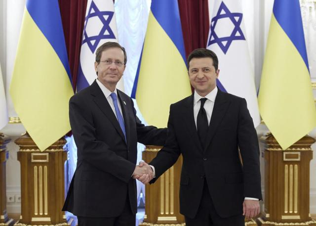 Ukrainian President Volodymyr Zelenskyy, right, shakes hands with Israeli President Isaac Herzog during a welcome ceremony ahead of their meeting in Kyiv, Ukraine, Tuesday, Oct. 5, 2021. (Ukrainian Presidential Press Office via AP)