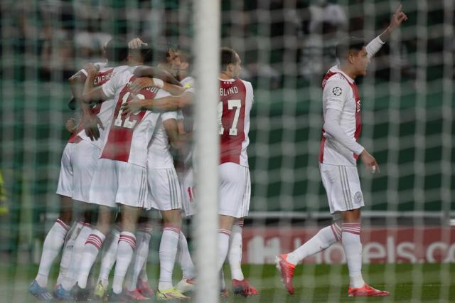 Ajax players celebrate after Sebastien Haller scored his side's second goal during a Champions League, Group C soccer match between Sporting CP and Ajax at the Alvalade stadium in Lisbon, Wednesday, Sept. 15, 2021. (AP Photo/Armando Franca)
