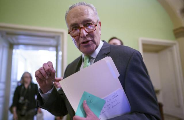 Senate Majority Leader Chuck Schumer, D-N.Y., talks to reporters as he leaves a news conference at the Capitol in Washington, Thursday, July 15, 2021. Schumer is scheduling a procedural vote for next Wednesday to begin debate on a still-evolving bipartisan infrastructure bill. (AP Photo/J. Scott Applewhite)