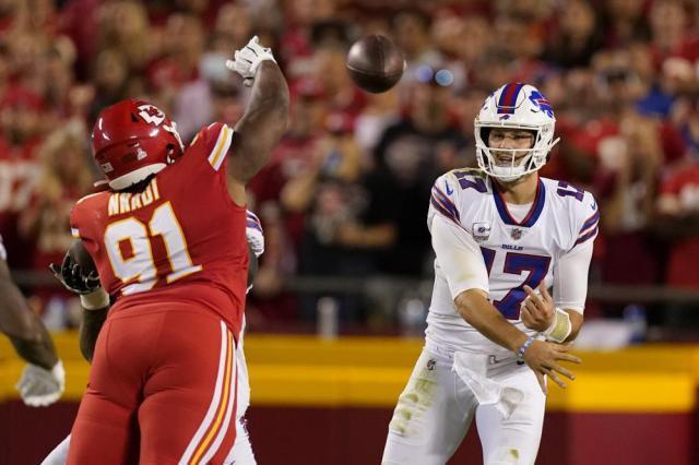 Buffalo Bills quarterback Josh Allen (17) throws over Kansas City Chiefs defensive tackle Derrick Nnadi (91) during the first half of an NFL football game Sunday, Oct. 10, 2021, in Kansas City, Mo. (AP Photo/Charlie Riedel)