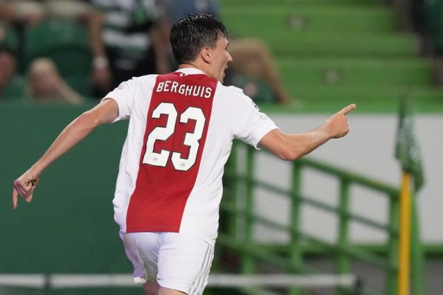 Ajax's Dusan Tadic celebrates after scoring his side's third goal during a Champions League, Group C soccer match between Sporting CP and Ajax at the Alvalade stadium in Lisbon, Wednesday, Sept. 15, 2021. (AP Photo/Armando Franca)