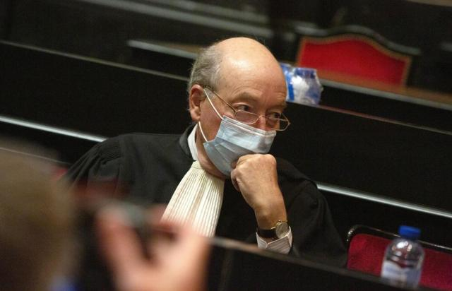 Lawyer for the European Commission Alain Foriers waits for the start of a hearing, European Commission vs AstraZeneca, at the main courthouse in Brussels, Wednesday, May 26, 2021. While the EU insists AstraZeneca has breached its contractual obligations, the company says it has fully complied with the agreement, arguing that vaccines are difficult to manufacture and it made its best effort to deliver on time. the European Union's executive branch will try to persuade a Brussels court Wednesday that the case is urgent enough to justify ordering the company to make an immediate delivery of the missing shots. (AP Photo/Virginia Mayo)