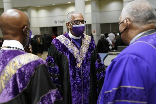 Senior Bishop Adam J Richardson Jr., center, greets other bishops prior to the opening worship service at the African Methodist Episcopal Church conference Tuesday, July 6, 2021, in Orlando, Fla. (AP Photo/John Raoux)