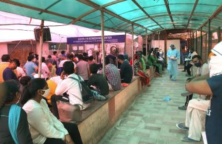 Latest on virus infections in New Delhi, India: Lack of beds slows Delhi's virus fight