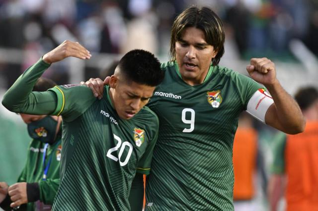Bolivia's Ramiro Vaca, left, celebrates with his teammate Marcelo Martins after scoring his side's opening goal against Peru during a qualifying soccer match for the FIFA World Cup Qatar 2022 at Hernando Siles stadium in La Paz, Bolivia, Sunday, Oct. 10, 2021. (Aizar Raldes/Pool via AP)