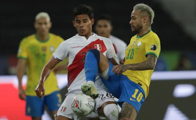 Brazil's Neymar, right, and Peru's Carlos Lora battle for the ball during a Copa America semifinal soccer match at Nilton Santos stadium in Rio de Janeiro, Brazil, Monday, July 5, 2021. (AP Photo/Silvia Izquierdo)