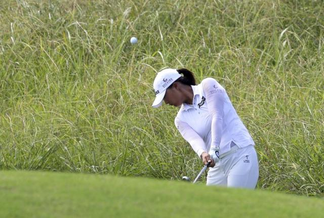 Jin Young Ko hits on the first hole during the third round of the LPGA Volunteers of America Classic golf tournament in The Colony, Texas, Saturday, July 3, 2021. (AP Photo/Richard W. Rodriguez)