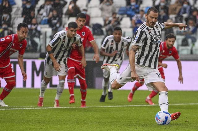 Juventus' Leonardo Bonucci, right, scores on a penalty kick during the Italian Serie A soccer match between Juventus and Sampdoria, in Turin, Italy, Sunday, Sept. 26, 2021. (Marco Alpozzi/LaPresse via AP)
